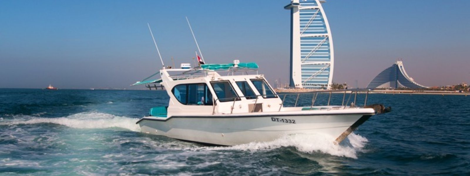 Cozmo 41 - Seamaster American Boat - Good For Fishing - Burj Al Arab at the backdrop