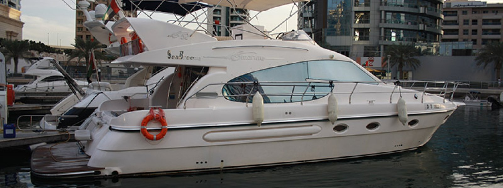 Cozmo 52 Feet Sea Breeze Yacht berthed near dubai Marina.