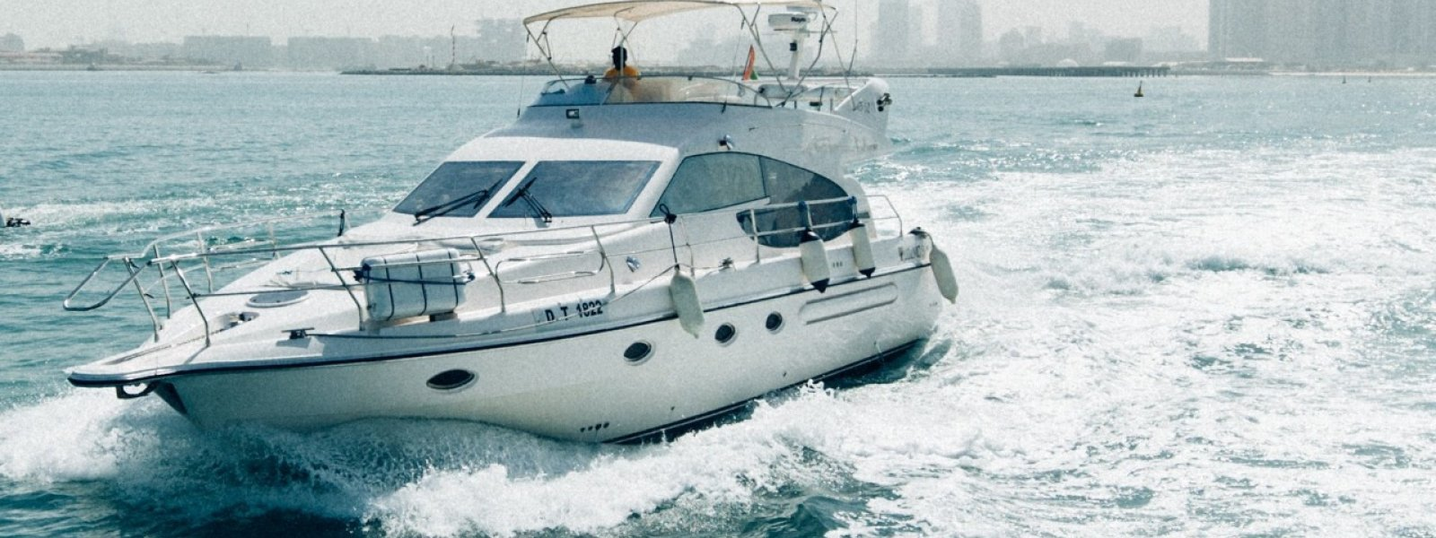 Cozmo 52 Feet Sea Breeze Yacht cruising near Burj-ul-arab