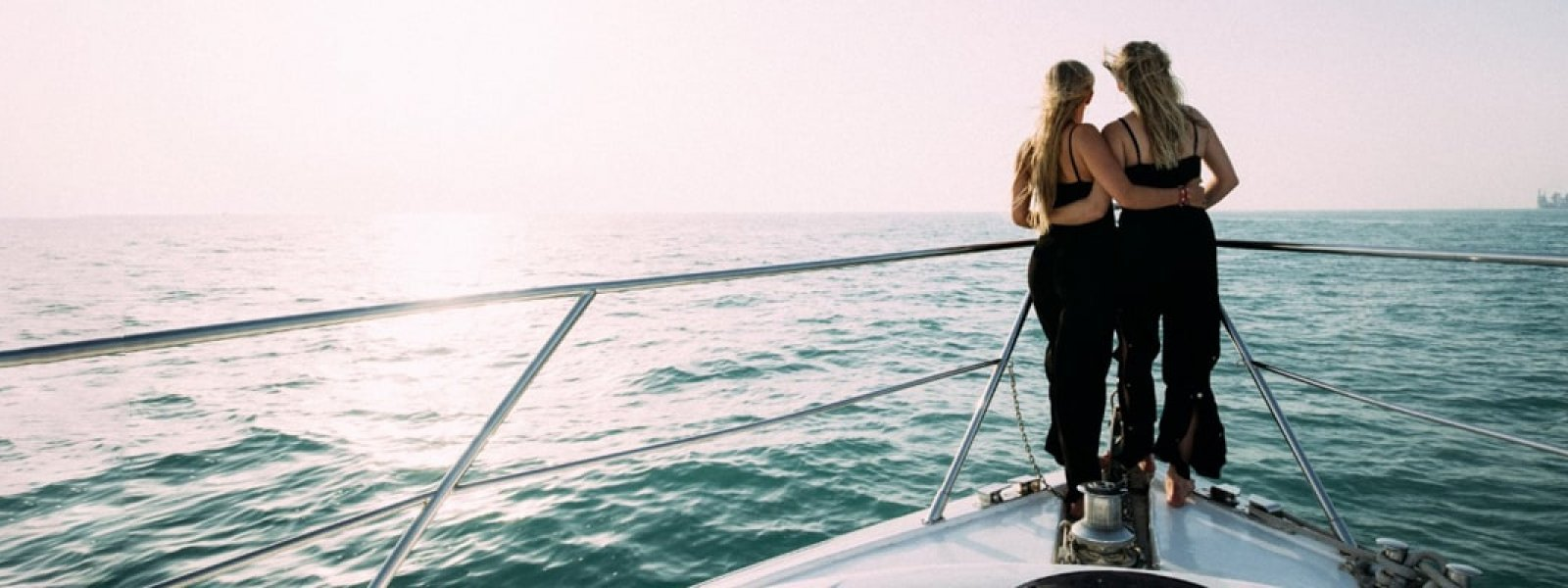 Girls on a luxury yacht enjoying their yacht trip in Dubai
