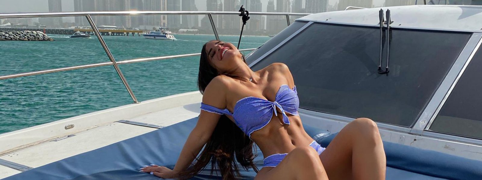 Lady enjoying the cruise on the front deck of the private yacht