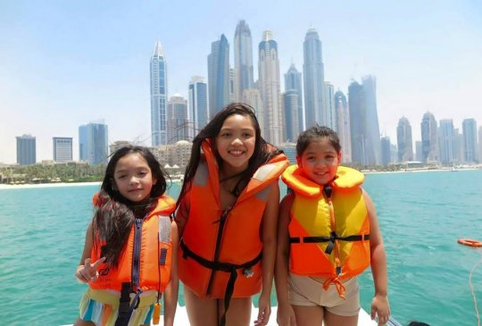 Teen Girls Enjoying Yacht Cruise at Dubai Marina
