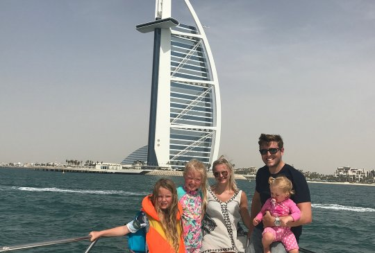 Happy Family on a Chartered Yacht at Burj Al Arab