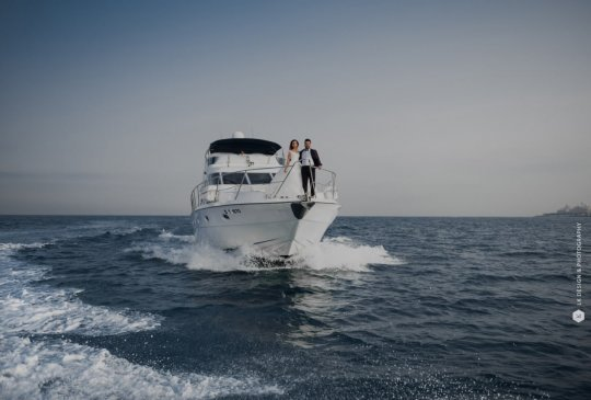 engaged couple cruising on a private yacht
