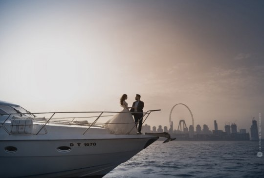 romantic engaged couple on luxury yacht deck